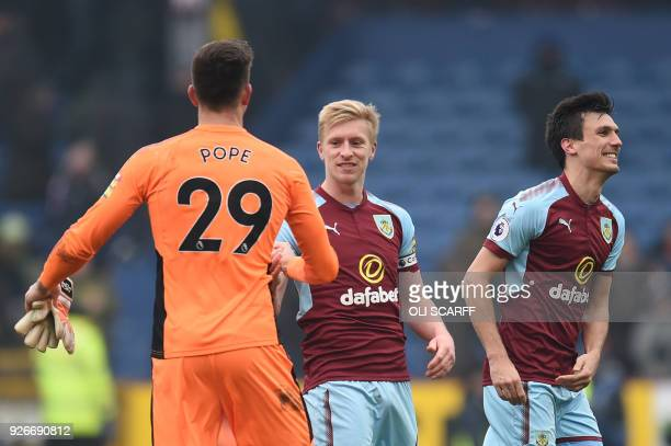 Burnley's English defender Ben Mee shakes hands with Burnley's English goalkeeper Nick Pope after the English Premier League football match between...