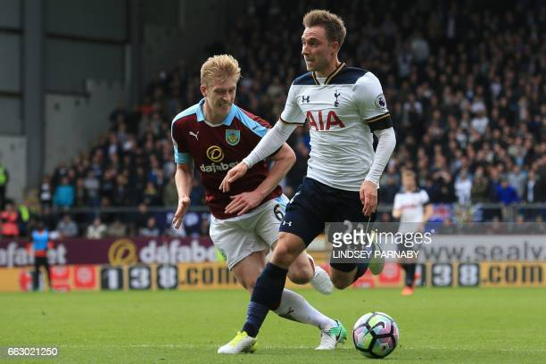 Burnley's English defender Ben Mee vies with Tottenham Hotspur's Danish midfielder Christian Eriksen during the English Premier League football match...