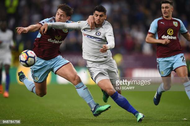 Burnley's English defender James Tarkowski vies with Chelsea's Spanish striker Alvaro Morata during the English Premier League football match between...