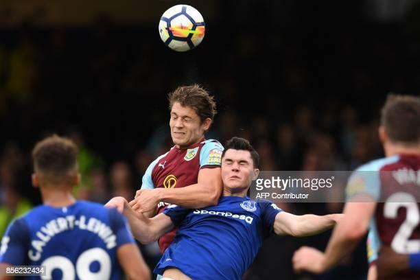 Burnley's English defender James Tarkowski vies with Everton's English defender Michael Keane during the English Premier League football match...