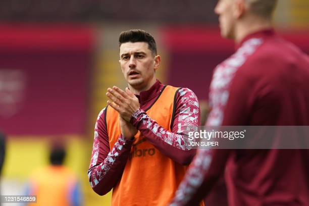 Burnley's English defender Matthew Lowton warms up ahead of the English Premier League football match between Burnley and Arsenal at Turf Moor in...