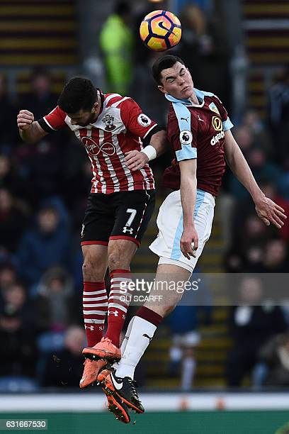 Burnley's English defender Michael Keane and Southampton's Irish striker Shane Long jumps for the ball during the English Premier League football...