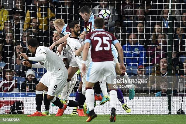 Burnley's English defender Michael Keane heads the ball in for their second goal during the English Premier League football match between Burnley and...