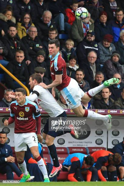 Burnley's English defender Michael Keane jumps for the ball with Tottenham Hotspur's Dutch striker Vincent Janssen during the English Premier League...