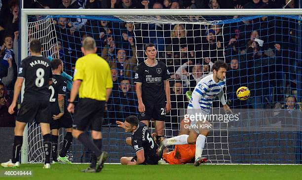 Burnley's English defender Michael Keane reacts as Queens Park Rangers' English striker Charlie Austin scores their second goal during the English...
