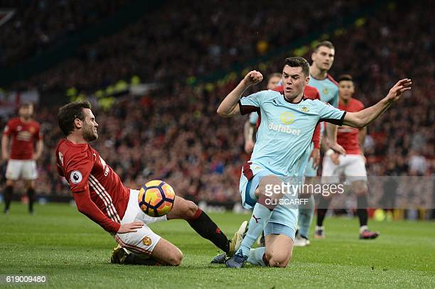 Burnley's English defender Michael Keane stops Manchester United's Spanish midfielder Juan Mata from shooting during the English Premier League...