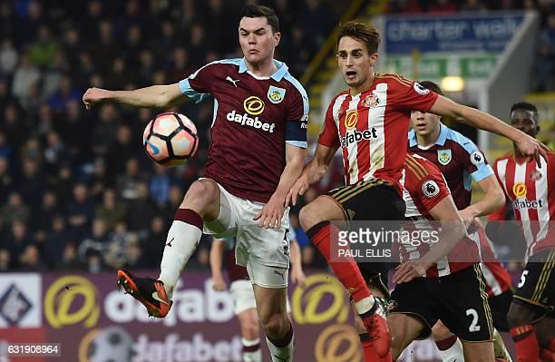 Burnley's English defender Michael Keane vies with Sunderland's Belgian midfielder Adnan Januzaj during the English FA Cup third round replay...