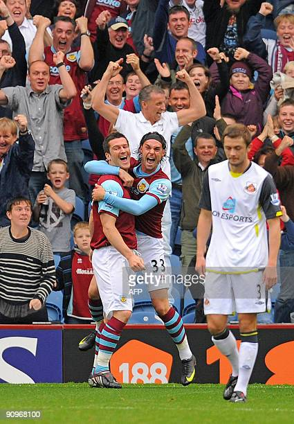 Burnley's English forward David Nugent celebrates after scoring Burnley's second goal with Burnley's English midfielder Chris Eagles during the...
