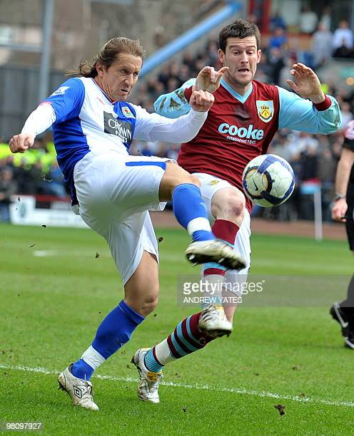 Burnley's English forward David Nugent fights for the ball with Blackburn Rovers' Spanish defender Míchel Salgado during their English Premier League...