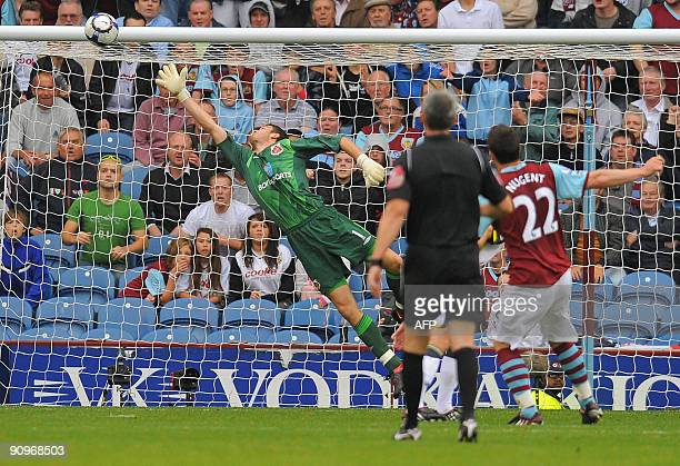 Burnley's English forward David Nugent scores Burnley's third goal past Sunderland's Scottish goalkeeper Craig Gordon during the English Premier...