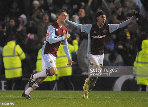 Burnley's English forward Jay Rodriguez celebrates after scoring the third goal forcing extra time during the Carling Cup semi final football match...
