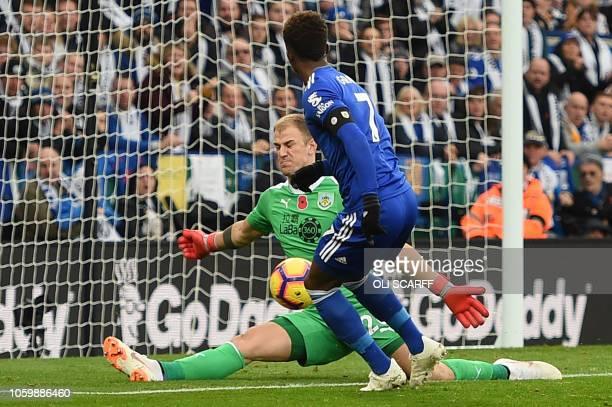 Burnley's English goalkeeper Joe Hart saves a shot from Leicester City's English midfielder Demarai Gray during the English Premier League football...