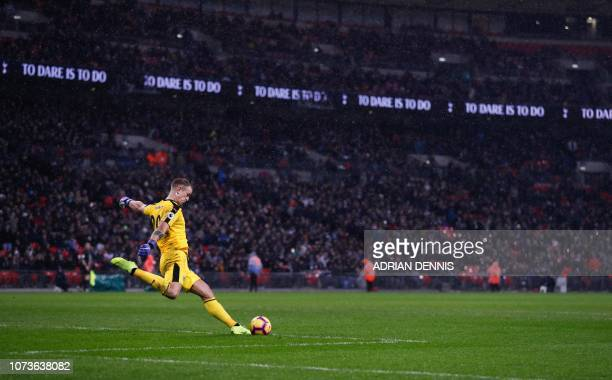 TOPSHOT Burnley's English goalkeeper Joe Hart takes a goal kick during the English Premier League football match between Tottenham Hotspur and...