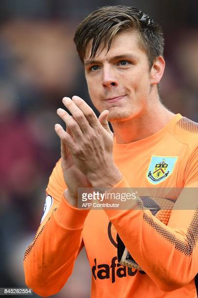 Burnley's English goalkeeper Nick Pope applauds the fans at fulltime of the English Premier League football match between Burnley and Crystal Palace...