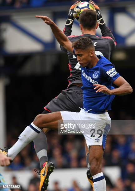 Burnley's English goalkeeper Nick Pope claims the ball under pressure from Everton's English striker Dominic CalvertLewin during the English Premier...