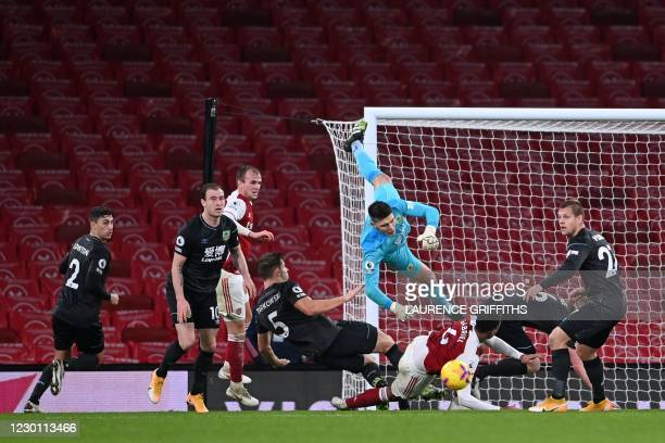 Burnley's English goalkeeper Nick Pope comes out to punch the ball clear in front of Arsenal's Brazilian defender Gabriel after a free kick was put...