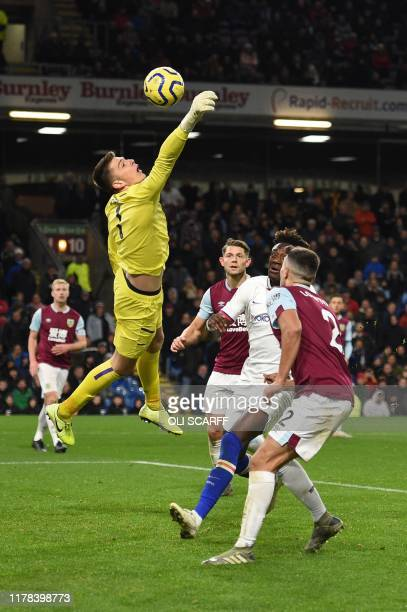 Burnley's English goalkeeper Nick Pope jumps in to try to glove the ball away during the English Premier League football match between Burnley and...