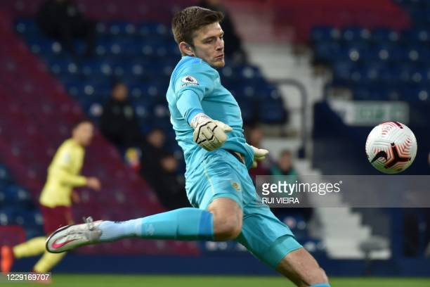 Burnley's English goalkeeper Nick Pope kicks the ball out during the English Premier League football match between West Bromwich Albion and Burnley...