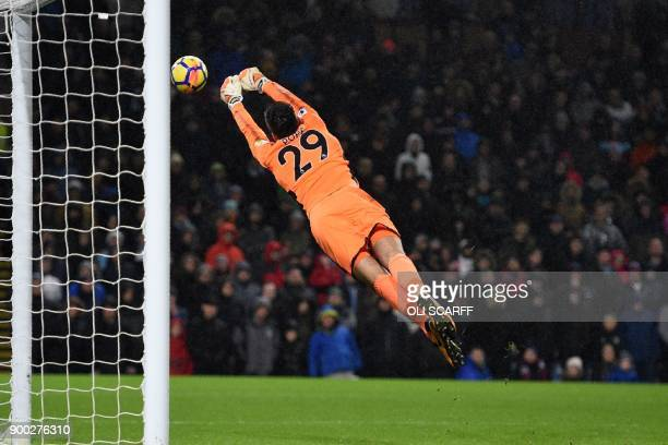 TOPSHOT Burnley's English goalkeeper Nick Pope makes a save during the English Premier League football match between Burnley and Liverpool at Turf...