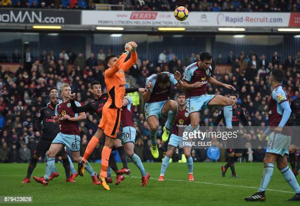 Burnley's English goalkeeper Nick Pope punches the ball clear during the English Premier League football match between Burnley and Arsenal at Turf...