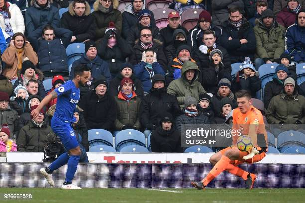 Burnley's English goalkeeper Nick Pope saves from Everton's English striker Theo Walcott during the English Premier League football match between...