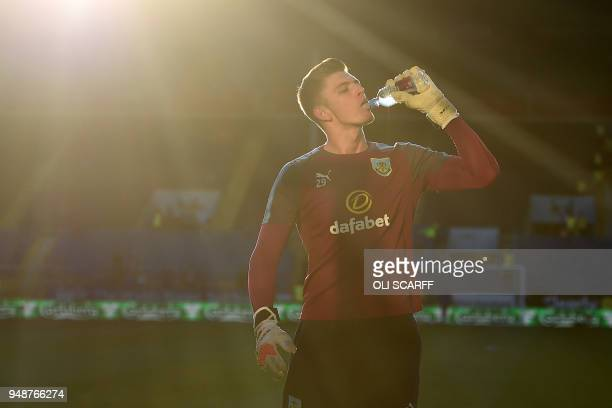 Burnley's English goalkeeper Nick Pope takes a drink during warm up ahead of the English Premier League football match between Burnley and Chelsea at...