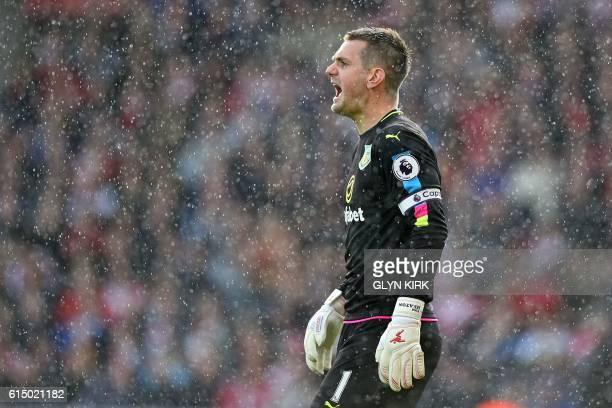 Burnley's English goalkeeper Tom Heaton shouts through the rain during the English Premier League football match between Southampton and Burnley at...
