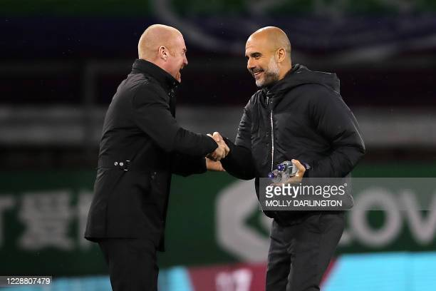 Burnley's English manager Sean Dyche and Manchester City's Spanish manager Pep Guardiola shake hands before the English League Cup fourth round...