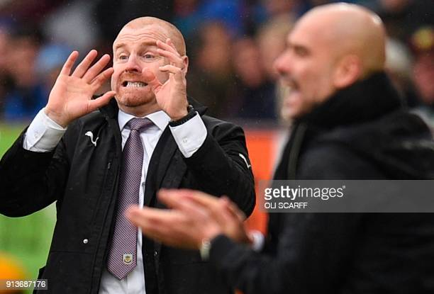 Burnley's English manager Sean Dyche and Manchester City's Spanish manager Pep Guardiola gesture on the touchline during the English Premier League...