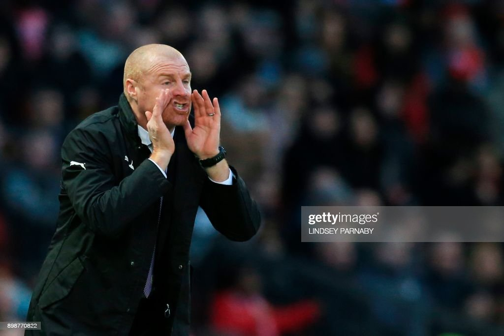 Burnley's English manager Sean Dyche gestures on the touchline during the English Premier League football match between Manchester United and Burnley at Old Trafford in Manchester, north west England, on December 26, 2017. / AFP PHOTO / Lindsey PARNABY / RESTRICTED TO EDITORIAL USE. No use with unauthorized audio, video, data, fixture lists, club/league logos or 'live' services. Online in-match use limited to 75 images, no video emulation. No use in betting, games or single club/league/player publications. /