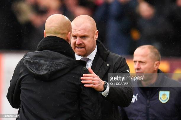 Burnley's English manager Sean Dyche shakes hands with Manchester City's Spanish manager Pep Guardiola at the end of the English Premier League...