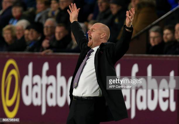 Burnley's English manager Sean Dyche shouts instructions to his players from the touchline during the English Premier League football match between...