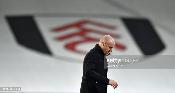 Burnley's English manager Sean Dyche walks off the pitch during the English FA Cup fourth round football match between Fulham and Burnley at Craven...