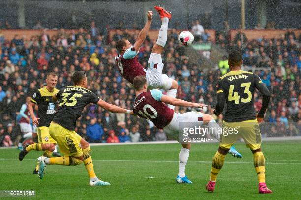 Burnley's English midfielder Ashley Westwood and Burnley's English striker Ashley Barnes go for an overhead effort but fail to connect during the...