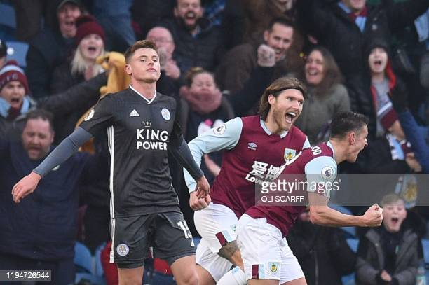 Burnley's English midfielder Ashley Westwood celebrates score their second goal as Leicester City's English midfielder Harvey Barnes reacts during...