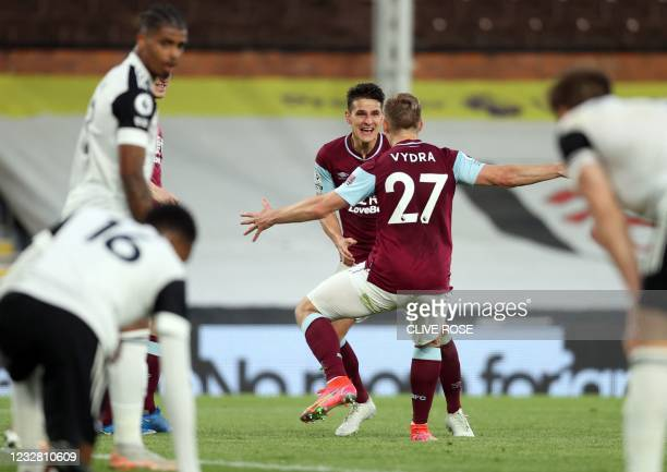 Burnley's English midfielder Ashley Westwood celebrates scoring his team's first goal during the English Premier League football match between Fulham...