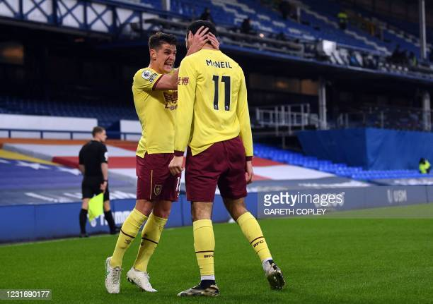 Burnley's English midfielder Ashley Westwood celebrates with Burnley's English midfielder Dwight McNeil after their second goal during the English...