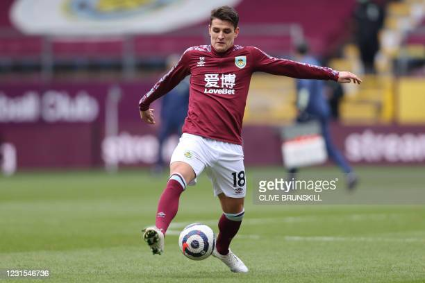 Burnley's English midfielder Ashley Westwood warms up ahead of the English Premier League football match between Burnley and Arsenal at Turf Moor in...