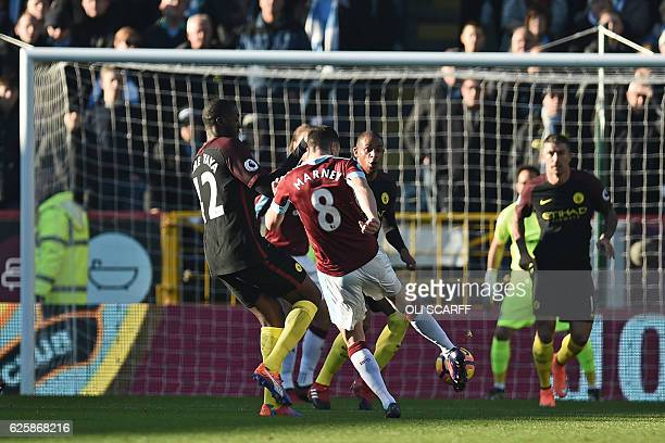 Burnley's English midfielder Dean Marney shoots to score the opening goal of the English Premier League football match between Burnley and Manchester...