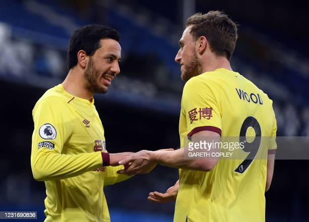 Burnley's English midfielder Dwight McNeil and Burnley's New Zealand striker Chris Wood celebrate the second goal during the English Premier League...