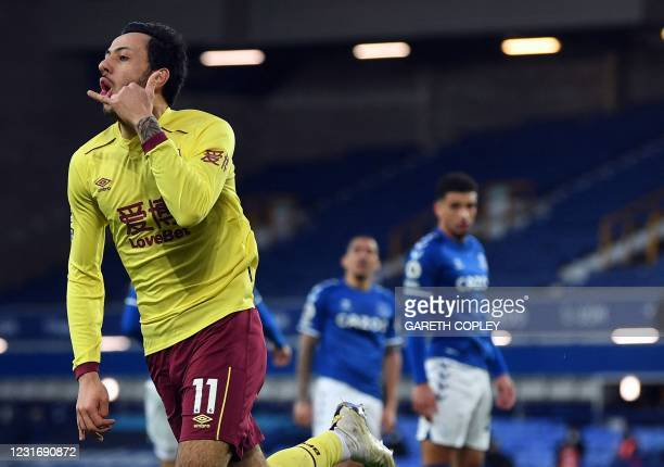 Burnley's English midfielder Dwight McNeil celebrates scoring his team's second goal during the English Premier League football match between Everton...