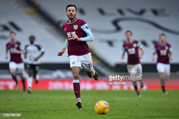 Burnley's English midfielder Dwight McNeil chases after the ball during the English FA Cup fourth round football match between Fulham and Burnley at...