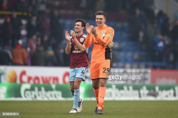 Burnley's English midfielder Jack Cork and Burnley's English goalkeeper Nick Pope applaud supporters on the pitch after the English Premier League...