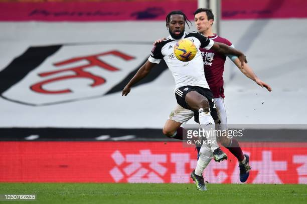 Burnley's English midfielder Jack Cork vies for the ball against Fulham's English midfielder Josh Onomah during the English FA Cup fourth round...