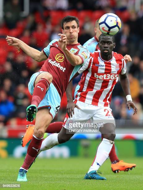Burnley's English midfielder Jack Cork vies with Stoke City's Senegalese defender Badou Ndiaye during the English Premier League football match...