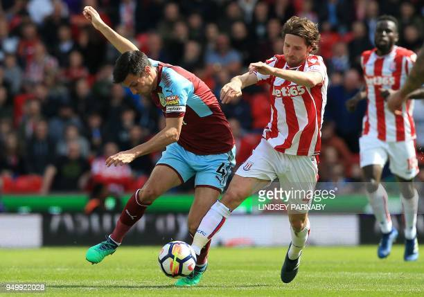 Burnley's English midfielder Jack Cork vies with Stoke City's Welsh midfielder Joe Allen during the English Premier League football match between...