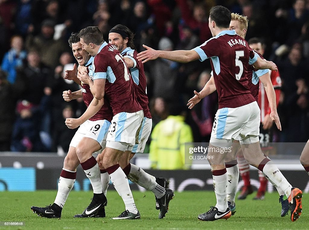 Burnley's English midfielder Joey Barton (L) celebrates with teammates after scoring the opening goal of the English Premier League football match between Burnley and Southampton at Turf Moor in Burnley, north west England on January 14, 2017. / AFP / Oli SCARFF / RESTRICTED TO EDITORIAL USE. No use with unauthorized audio, video, data, fixture lists, club/league logos or 'live' services. Online in-match use limited to 75 images, no video emulation. No use in betting, games or single club/league/player publications. /