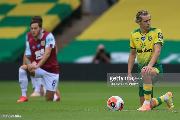 Burnley's English midfielder Josh Brownhill and Norwich City's English midfielder Todd Cantwell 'takes a knee' in support of the Black Lives Matter...