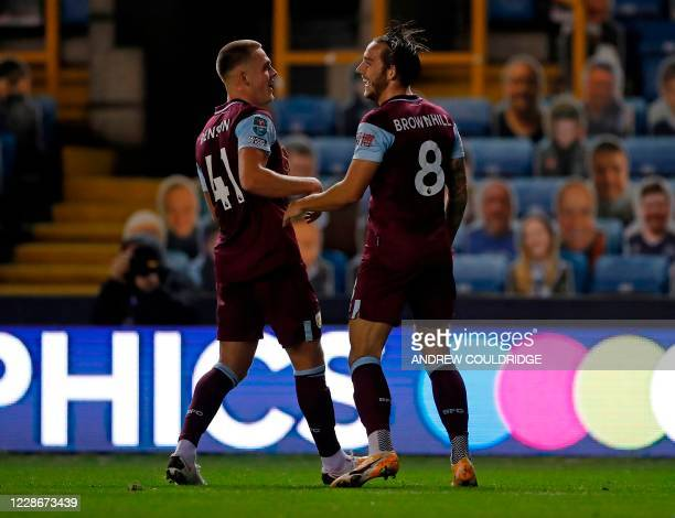 Burnley's English midfielder Josh Brownhill celebrates scoring the opening goal during the English League Cup third round football match between...