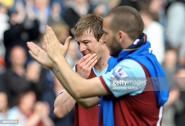 Burnley's English midfielder Wade Elliott and Burnley's English striker Martin Paterson after their 40 defeat a result which confirms Burnley's...